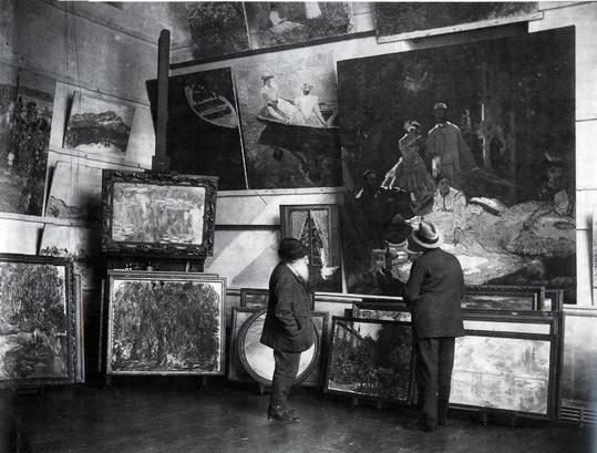 Photograph of Monet in his second studio at Giverny by Choumoff with the Kimbell's painting at the base of the easel behind the artist. Copyright Jean Loup Charmet, Photographe.