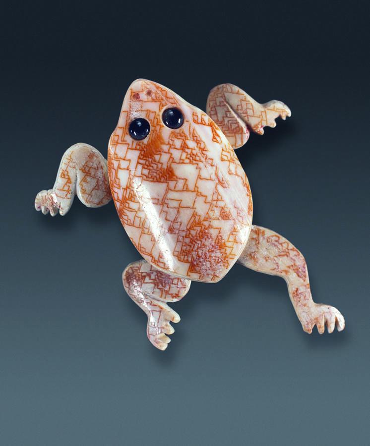 Carving of a frog, 700–800, Topoxte, Guatemala, Shell and quartz, 2 1/8 x 2 3/4 x 1/4 in. (6.7 x 7 x 0.4 cm), Ministerio de Cultura y Deportes—Museo Nacional de Arqueología y Etnología, Guatemala City, Courtesy Peabody Essex Museum, photograph © 2009 Jorg