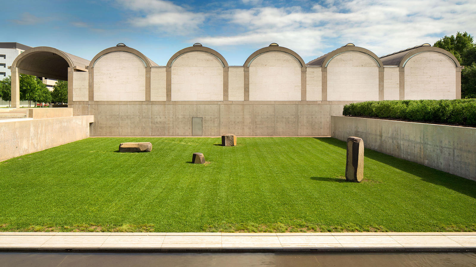 Kahn Building, south facade with the Noguchi Garden, photo by Nic Lehoux