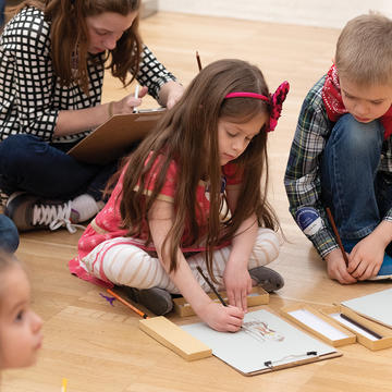 Children sketch in the galleries during an education program